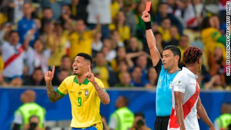 Chilean referee Roberto Tobar shows the red card to Brazil's Gabriel Jesus.