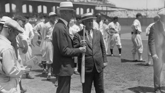 """American League manager Connie Mack, left, and National League manager John McGraw play a sandlot """"hand-over-hand"""" game to determine which team would bat first in the 1933 All-Star Game."""