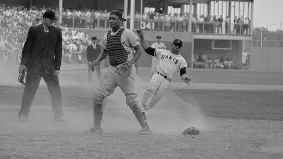 Willie Mays slides into home during the 1964 All-Star Game at New York's Shea Stadium. Mays holds the career record for most All-Star hits (23) and stolen bases (six).