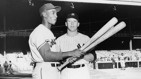 Future Hall of Famers Ernie Banks, left, and Mickey Mantle talk before the All-Star Game in Baltimore in 1958. That year, both were leading their respective leagues in home runs.