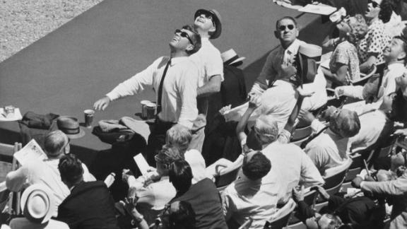 US President John F. Kennedy watches the flight of a ball during the All-Star Game in Washington in 1962.