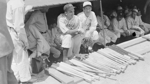 A look inside a dugout at the first All-Star Game in 1933. Kneeling together at center are Carl Hubbell and Lefty Grove. The All-Star Game has been held every year except for 1945, when World War II forced restrictions on travel. From 1959 to 1962, there were actually two All-Star Games each season.