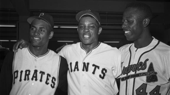 Three National League stars — from left, Roberto Clemente, Willie Mays, and Hank Aaron — stand together for a victory portrait after the All-Star Game in 1961. Aaron appeared in more All-Star Games than any other player (25).