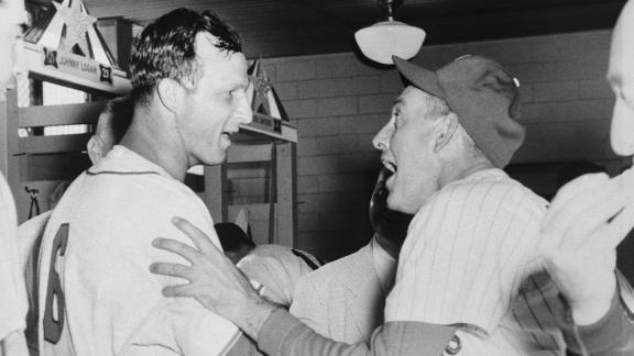 Stan Musial, left, is congratulated by National League manager Mayo Smith after hitting a walk-off home run to win the All-Star Game in 1955.