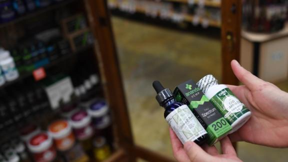 BOULDER, CO - DECEMBER 4: Sarah Shebanek, wellness buyer for  Alfalfa's, works with the CBD oil supplements the store sells on December 4, 2017 in Boulder, Colorado. (Photo by RJ Sangosti/The Denver Post via Getty Images)