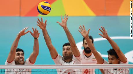 (From L) Iran's Shahram Mahmoudi, Iran's Seyed Mohammad Mousavi Eraghi and Iran's Farhad Ghaemi jump up to block the ball during the men's quarter-final volleyball match between Italy and Iran at Maracanazinho Stadium in Rio de Janeiro on August 17, 2016, during the Rio 2016 Olympic Games. / AFP / Eric FEFERBERG        (Photo credit should read ERIC FEFERBERG/AFP/Getty Images)