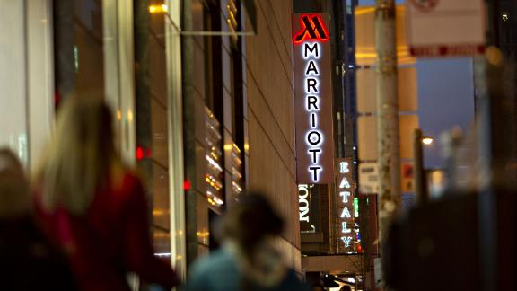 Signage is illuminated outside a Marriott International Inc. hotel at night in Chicago, Illinois, U.S., on Friday, Nov. 30, 2018. A cyber breach in Starwood's reservation system had allowed unauthorized access to information about as many as 500 million guests since 2014. Photographer: Daniel Acker/Bloomberg via Getty Images