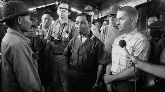 Perot, right, listens to a North Vietnamese prisoner in April 1970. Perot received national attention for his efforts during the Vietnam War to create better conditions for US prisoners of war. He traveled to Laos, where he met with ambassadors from Russia and North Vietnam. POWs later claimed that the publicity ultimately resulted in better treatment by the North Vietnamese.