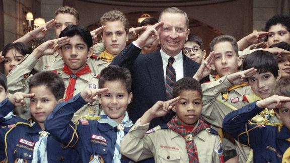 Perot, an Eagle Scout, gives the Boy Scout salute at a luncheon in New York in June 1990. He was receiving a Boy Scouts Award for Courage.