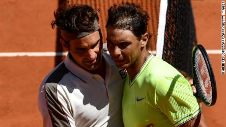 Roger Federer and Rafael Nadal embrace after their French Open semifinal Nadal won.