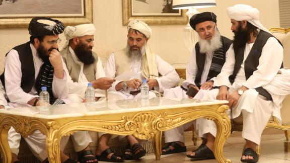 Mohammad Nabi Omari (L), a Taliban member formerly held by the US at Guantanamo Bay and reportedly released in 2014 in a prisoner exchange, sits with other members during the second day of the Intra Afghan Dialogue talks in the Qatari capital Doha on July 8, 2019. - Dozens of powerful Afghans met with a Taliban delegation on July 8, amid separate talks between the US and the insurgents seeking to end 18 years of war. The separate intra-Afghan talks are attended by around 60 delegates, including political figures, women and other Afghan stakeholders. (Photo by KARIM JAAFAR / AFP)        (Photo credit should read KARIM JAAFAR/AFP/Getty Images)