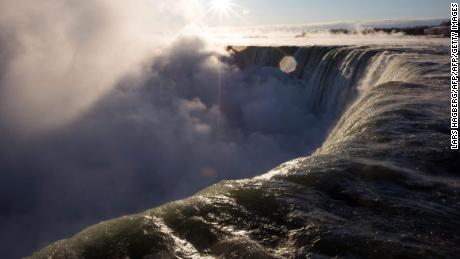 Man swept over Niagara Falls survives