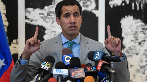 Venezuelan opposition leader and self-proclaimed interim president Juan Guaido offers a press conference before participating in the Conindustria 2019 congress at the Metropolitan University in Caracas on June 26, 2019. - Venezuela opposition leader Juan Guaido on Wednesday dismissed government claims of an attempted coup, and said he would continue calls on the armed forces to abandon President Nicolas Maduro. (Photo by Federico PARRA / AFP)        (Photo credit should read FEDERICO PARRA/AFP/Getty Images)