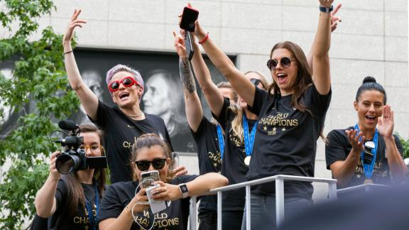 Member of the U.S. women's soccer team, including Megan Rapinoe, rear left, and Alex Morgan, right foreground, stand on a float before being honored with a ticker tape parade along the Canyon of Heroes, Wednesday, July 10, 2019 in New York. The U.S. national team beat the Netherlands 2-0 to capture a record fourth Women's World Cup title.(AP Photo/Craig Ruttle)