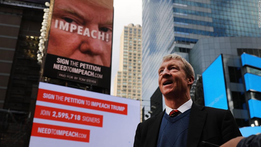 Steyer stands in front of one of the impeachment billboards he funded in New York's Times Square in November 2017.