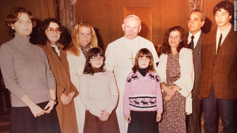 Pope John Paul II with Emanuela Oralndi (pink jumper, center), and (from right) her brother Pietro, father Ercole, and mother Maria.