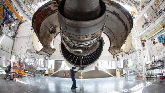 A aircraft maintenance technician works on the engine of an Airbus airplane of the airline company Air France in a maintenance facility at Roissy-Charles de Gaulle Airport, in Roissy, north of Paris, on June 27, 2019. (Photo by JOEL SAGET / AFP)        (Photo credit should read JOEL SAGET/AFP/Getty Images)