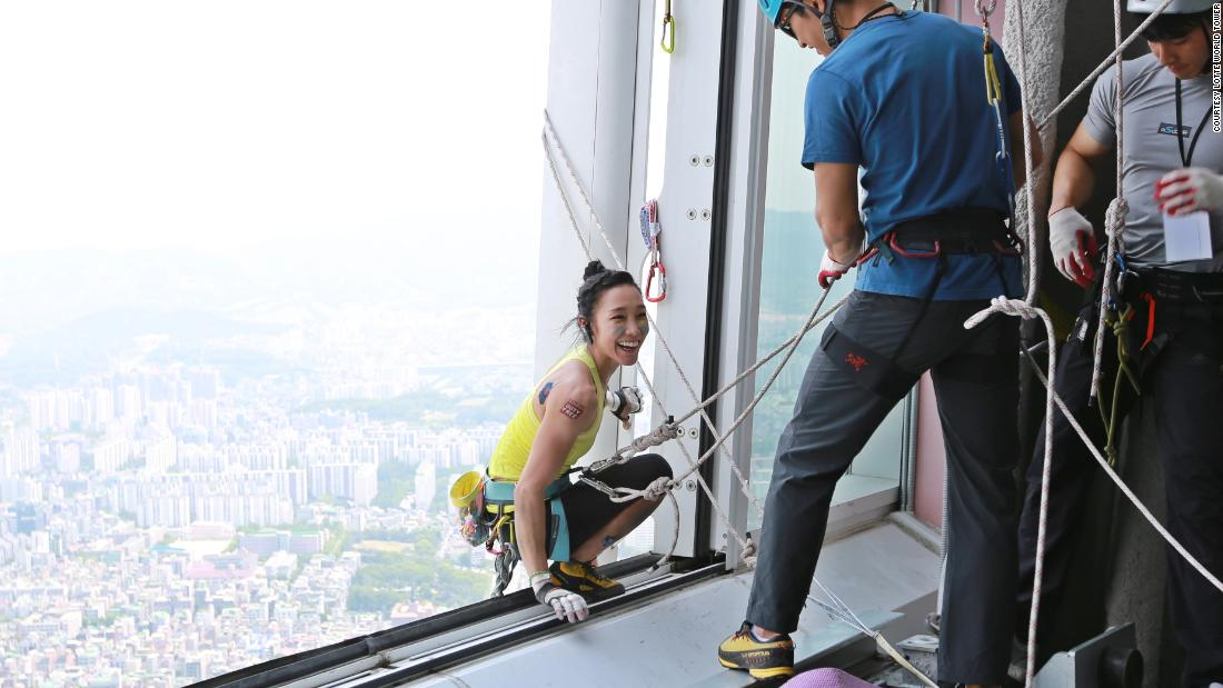"Kim changing rope lines as she climbs the Lotte World Tower, Seoul in 2017. When she reached the top she was met by her husband and her brother. ""(They) expected to see me exhausted,"" she said, ""but I was just too happy."""