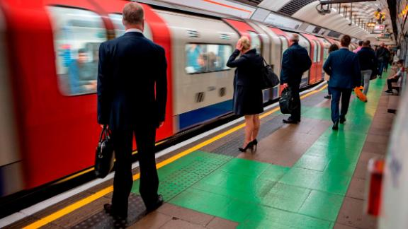 """Passengers stand to the side of the newly painted area as they wait to board a train on the Victoria line platform at King's Cross St. Pancras underground station in London on September 14, 2017. Seasoned Londoners are complaining they're being robbed of their """"competitive commuting advantage,"""" after new platform markings on the underground reveal where best to position yourself to quickly enter carriages. / AFP PHOTO / Tolga AKMEN        (Photo credit should read TOLGA AKMEN/AFP/Getty Images)"""