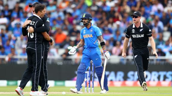 Trent Boult of New Zealand celebrates bowling Virat Kohli of India lbw.