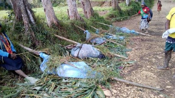A Facebook post from local officials showed bodies wrapped in blue bags as they were prepared for transport out of the village.