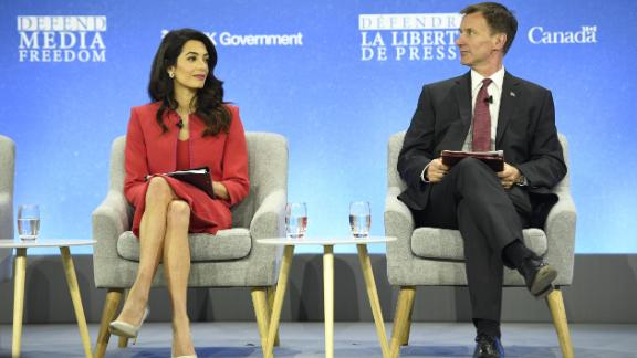 Human rights lawyer Amal Clooney(L) and UK