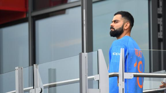 Virat Kohli walks back to the changing room after losing the semifinal.