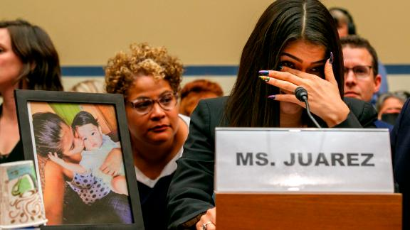 Yazmin Juárez, reacts as a photos of her daughter, Mariee, who died after being released from detention by U.S. Immigration and Customs Enforcement, is placed next to her at a House Oversight subcommittee hearing on Civil Rights and Civil Liberties to discuss treatment of immigrant children at the southern border, Wednesday, July 10, 2019, on Capitol Hill in Washington. (AP Photo/Jacquelyn Martin)
