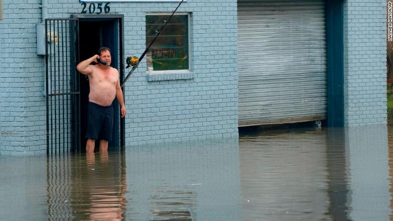 David Fox makes a call on Wednesday, July 10, from his business on Poydras Street in New Orleans.