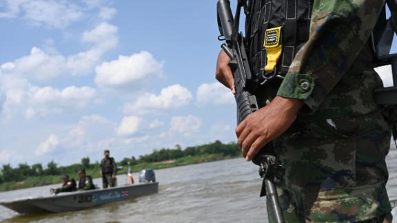 Armed Thai navy personnel  in a boat during a patrol along the Mekong river bordering Thailand and Laos on May 23.