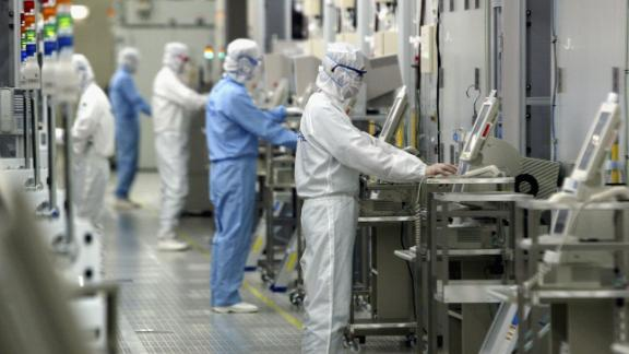 Technicians at work in the clean room of the Fab Equipment at a semiconductor company, Renesas Technology Corp. in Ibaraki, Japan.