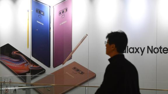 A man walks past an advertisement for the Samsung Galaxy Note9 at the company
