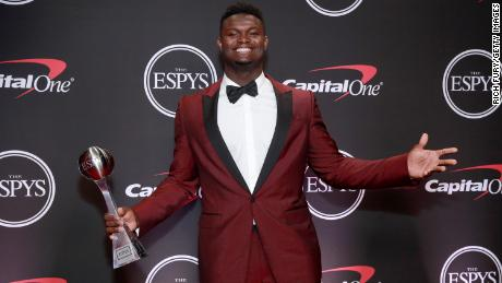 Zion Williamson poses with his ESPY for Best College Athlete.