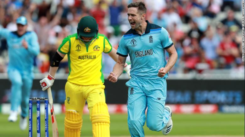 Chris Woakes of England celebrates taking the wicket of David Warner.
