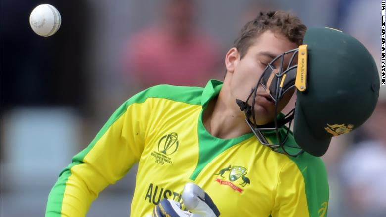 Australia's Alex Carey reacts after being hit by a bouncer from England's Jofra Archer.