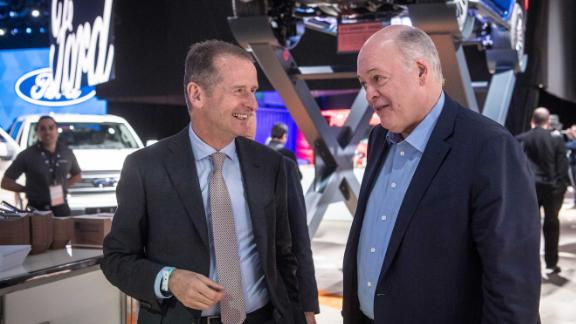 14 January 2019, US, Detroit: Jim Hackett (r), CEO of Ford, and Herbert Diess, CEO of VW, talk about the fair together. Industry experts expect the announcement of a cooperation between VW and Ford in the light commercial vehicle sector. Photo: Boris Roessler/dpa (Photo by Boris Roessler/picture alliance via Getty Images)