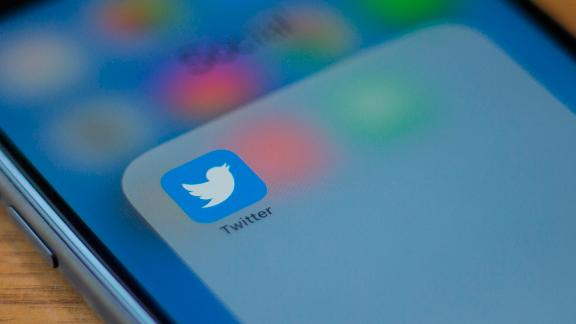 """The Twitter logo is seen on a phone in this photo illustration in Washington, DC, on July 10, 2019. - Twitter is moving to filter out inappropriate content based on religion as part of its effort to curb hate speech. In a policy update on July 9, 2019, Twitter said it would take down """"dehumanizing language"""" that targets specific religious groups.Examples shown by Twitter that would be removed would be description of a members of a religion as """"disgusting"""" or """"filthy animals."""" (Photo by Alastair Pike / AFP)        (Photo credit should read ALASTAIR PIKE/AFP/Getty Images)"""