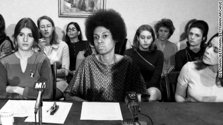 Forty-six women employees of male-dominated Newsweek magazine conduct a press conference here March 16 to announce they are suing the magazine under the 1964 Civil Rights Act. Charging discrimination in jobs and hiring, they said they are 'forced to assume a subsidiary role simply because of their sex.' Seated (Left to Right) are: employees Patricia Lynden, Mary Pleshette, Eleanor Holmes Norton and ACLU legal director Lucy Howard.