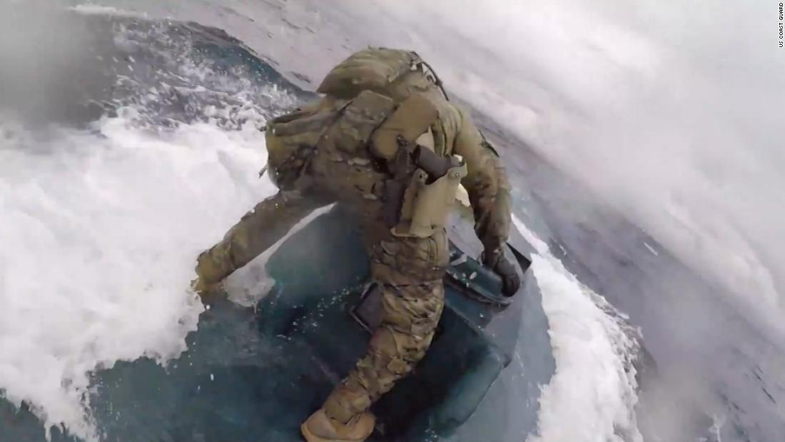 Coast Guardsman jumps onto moving submarine full of drugs