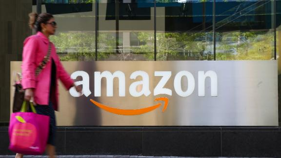 TORONTO, CANADA - 2019/06/27: A woman walks past an Amazon logo outside a building in Toronto. (Photo by Dinendra Haria/SOPA Images/LightRocket via Getty Images)