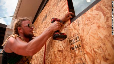 Matt Harrington enters a Vans shoe store near the French Quarter in New Orleans as Tropical Storm approaches Barry.