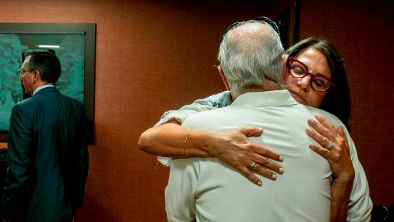 Tanya Gersh, a Montana real estate agent, embraces her father Lloyd Rosenstein following a hearing at the Russell Smith Federal Courthouse on Thursday, July 11, 2019, in Missoula. Gersh is the plaintiff in a harassment lawsuit filed against Daily Stormer publisher Andrew Anglin. Gersh, who is Jewish, said she and her family received hundreds of threatening messages, many of them anti-Semitic. (Ben Allen/The Missoulian via AP)