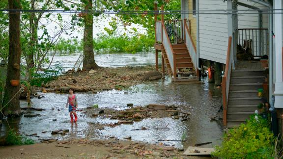 Four-year-old Delilah Campbell clears out driftwood and other debris in preparation of Tropical Storm Barry near New Orleans on Thursday.