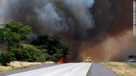A plume of smoke from a brush fire closes Kuihelani Highway in Central Maui, Hawaii, Thursday, July 11, 2019. Hawaii emergency officials ordered an evacuation on Maui due to the runaway brush fire. (Matthew Thayer/The News via AP)