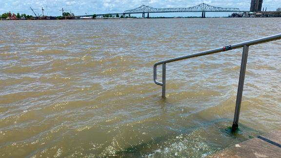 The Mississippi River laps at the stairs on a protective levee on Thursday, July 11, in New Orleans as Tropical Storm Barry approaches.