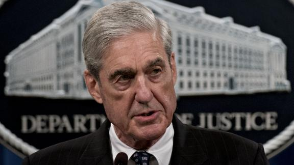 """Robert Mueller, special counsel for the U.S. Department of Justice, speaks at the Department of Justice (DOJ) in Washington, D.C., U.S., on Wednesday, May 29, 2019. Mueller said he found """"insufficient evidence to charge a broader conspiracy"""" involving the Trump campaign but didn"""