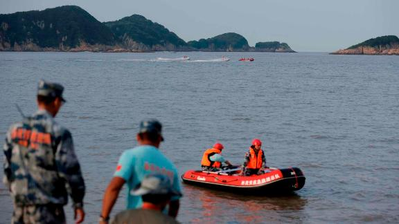Chinese rescuers search for the 9-year-old missing girl Zhang Zixin along the coastline in Xiangshan county, Ningbo city, east China's Zhejiang province, 11 July.