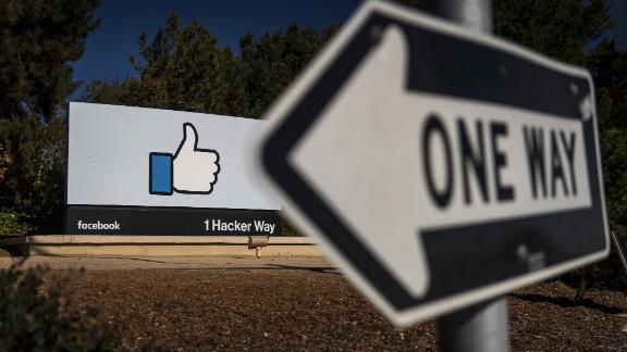 Signage is displayed outside Facebook Inc. headquarters in Menlo Park, California, U.S., on Tuesday, Oct. 30, 2018. Facebook Inc., which had warned of rising costs and slowing growth, reported quarterly revenue roughly in line with expectations and profit that beat analysts' forecasts. And despite scandals around fake news and election interference, it added more users, too. Photographer: David Paul Morris/Bloomberg via Getty Images
