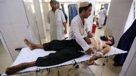 An injured man receives treatment at the hospital, after a suicide attack in Jalalabad, Afghanistan on July 12.
