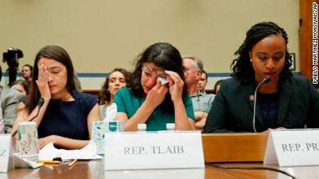 Rep. Rashida Tlaib, D-Mich., center, wipes her eyes after testifying before the House Oversight Committee hearing on family separation and detention centers, Friday, July 12, 2019 on Capitol Hill in Washington. Sitting at the panel with Tlaib are Rep. Alexandria Ocasio-Cortez, D-NY., left, and Rep. Ayanna Pressley, D-Mass., right. (AP Photo/Pablo Martinez Monsivais)
